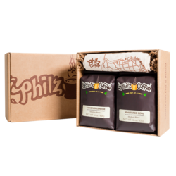 A Philz Box with the logo on it with 1 bag of Silken Splendor coffee, 1 bag of Philtered Soul coffee, 1 Philz tote bag and crinkle paper in the box.