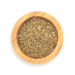 A scoop of anise in a wood spice jar
